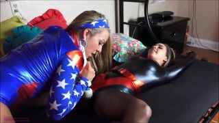 Two Superheroine Cosplayers sharing a vibrator