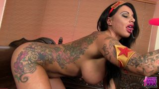 Sexy tattooed Wonder Woman cosplayer fingering herself until she cums hard