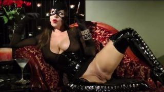 Batgirl cosplayer smoking while showing off her tight pussy