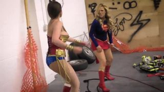 Supergirl and Wonderwoman cosplayers battle it out in sexy wrestling