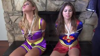 Batgirl and Supergirl cosplayers are overpowered and left in bondage