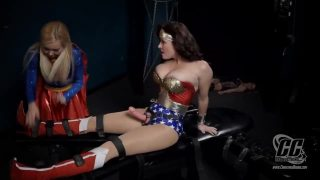 Supergirl and Wonder Woman cosplayers have lesbian foursome with sexy villains