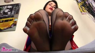 Cute Supergirl cosplayer licks her nylon feet
