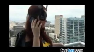Batgirl cosplayer gives footjob with stockings on