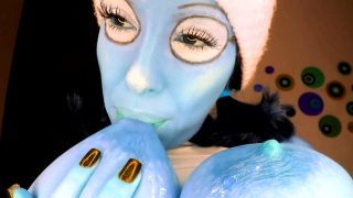 Smurfette cosplayer sucking on her massive tits and flashing her pussy
