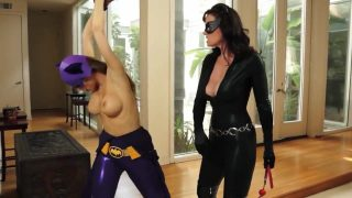 Catwoman cosplayer ties up and punishes Batgirl
